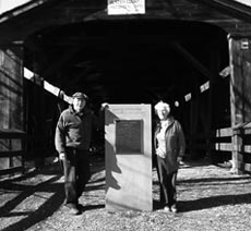 Jean and Rosener Wheeler flank the dedication monument at Perrine's Bridge in February 2006.
