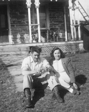 1817 Deyo House with Concetta and friend and neighbor, Mike Yess, chatting on the lawn. 1946.