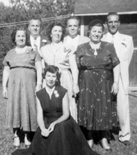 Standing -- Concetta, John, Mary, Frank, Anna, and Joseph, kneeling is Rose, at the farm, 1954.