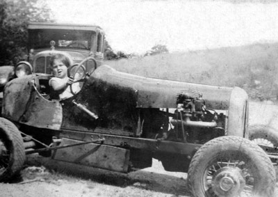 Mary Ann Piskur sits in her uncle's race car, circa 1937. The car ran at many tracks including some in Ulster, Orange, and Dutchess Counties.